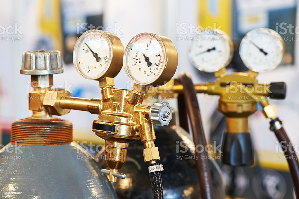 welding acetylene gas cylinder tank with gauge stock photo