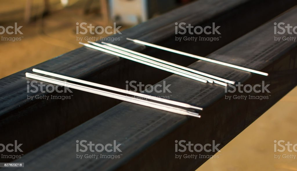 Welding electrodes on a big piece of metal stock photo