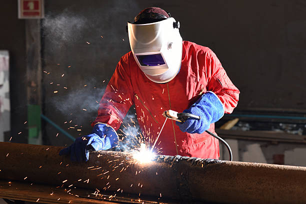 Welding engineer Electrical welding grinding stock pictures, royalty-free photos & images