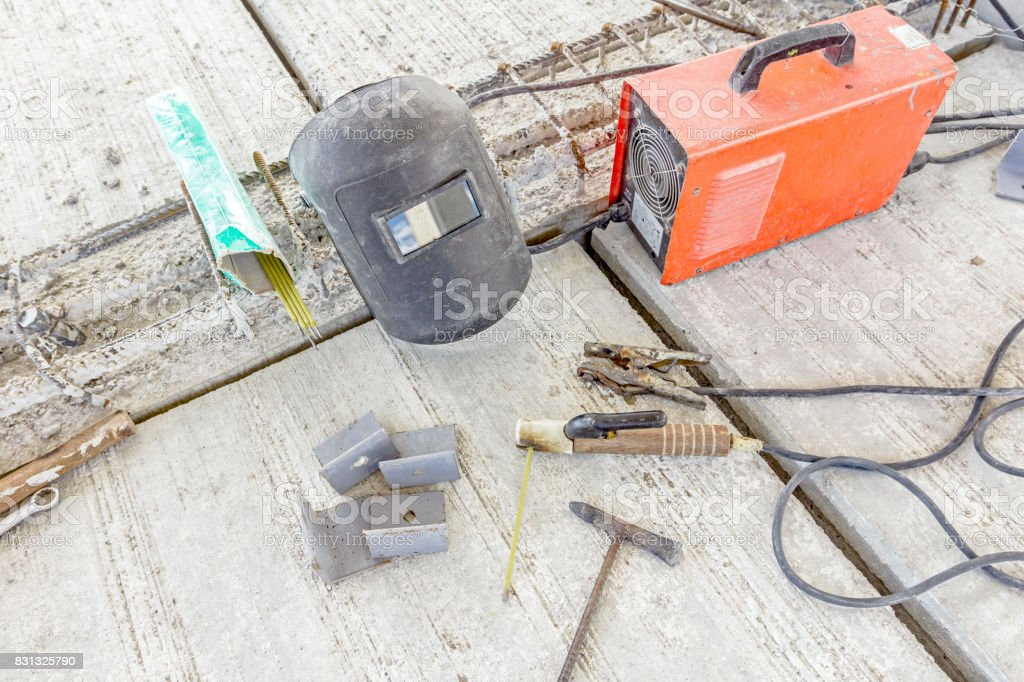Welding equipment with shield and welder torch, necessary tools stock photo