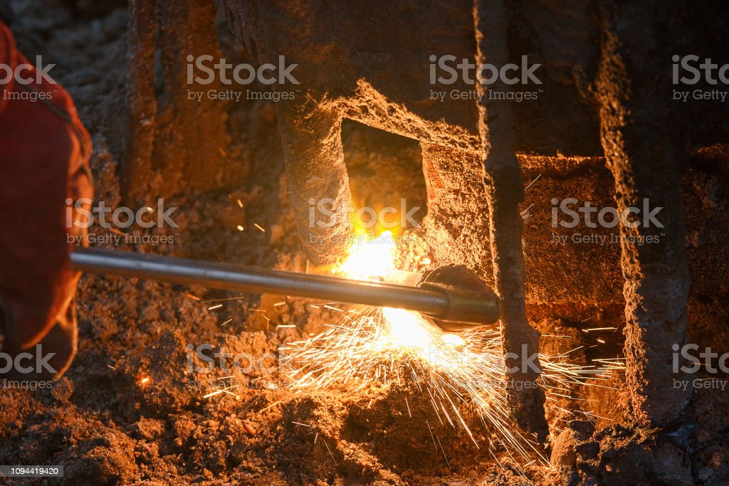 Welding machine with melting metal drops and sparks of sparks.