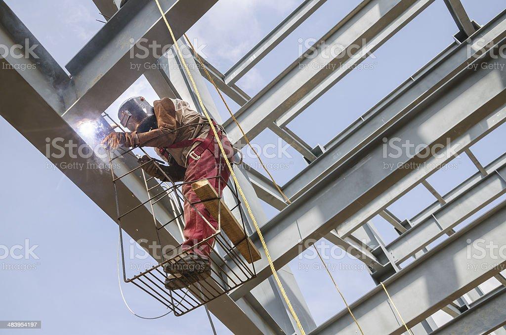 Welding metal columns stock photo