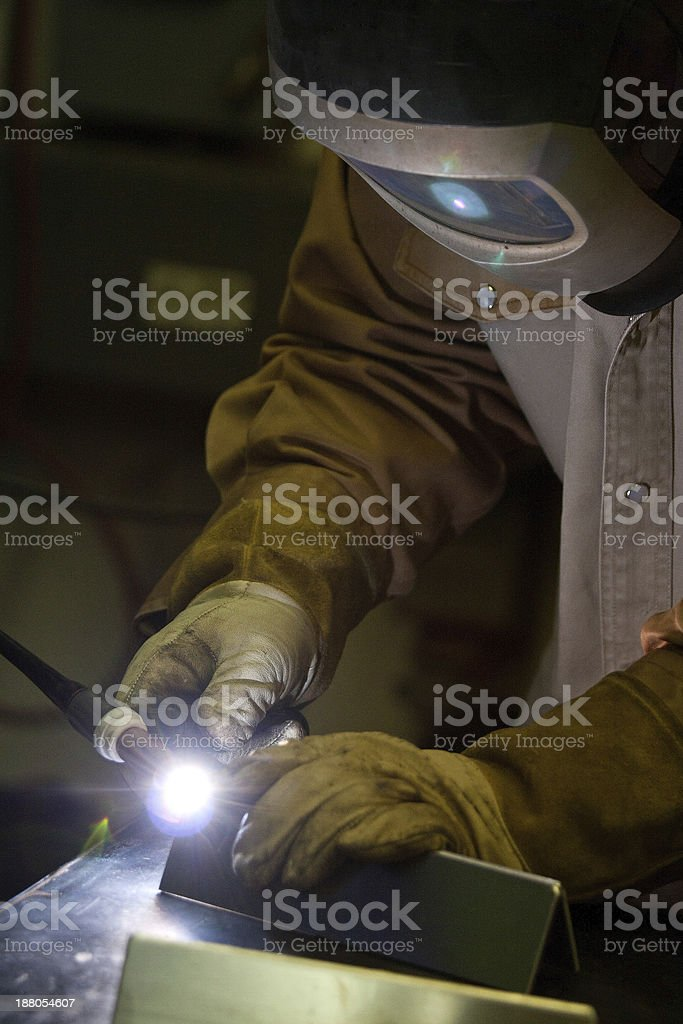 Welder TIG welding plate metal.