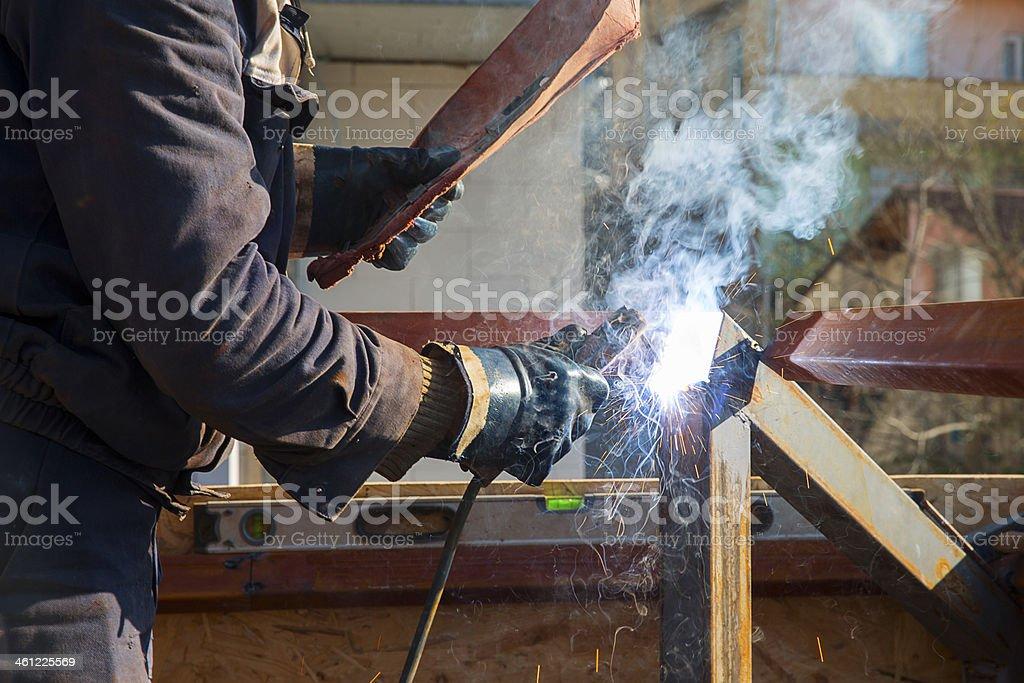 Worker is welding.