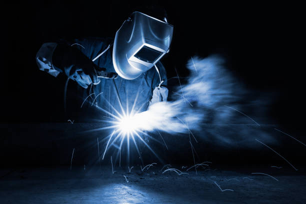 Welding Closeup industrial Worker at the factory welding metalwork stock pictures, royalty-free photos & images