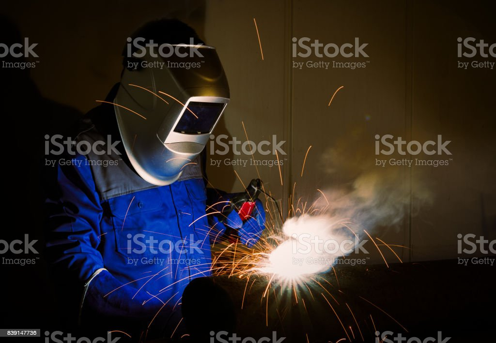 Closeup of industrial worker at the factory welding.