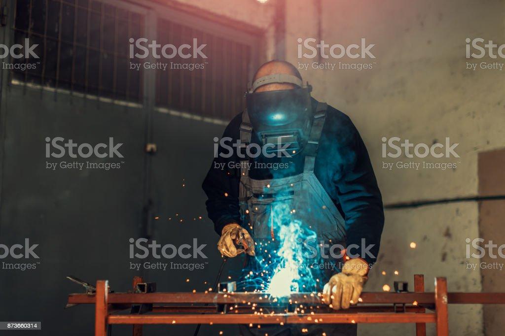 worker with welding tool