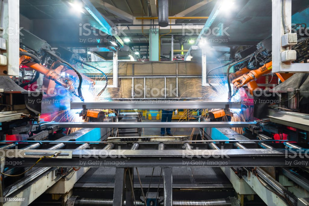 Welding robot, the process of welding a metal profile. stock photo