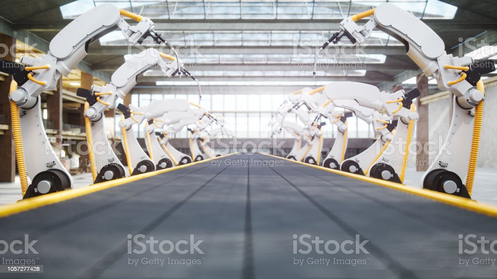 Welding Robots And Conveyor Belt In Automated Factory stock photo
