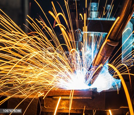 istock Welding robots movement in a car factory 1097678286