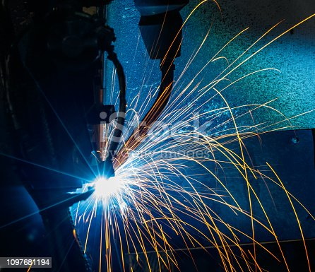 istock Welding robots movement in a car factory 1097681194