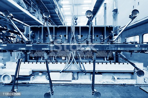 846859964 istock photo Welding robots movement in a car factory 1135242586