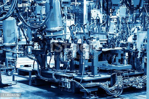 846859964 istock photo Welding robots movement in a car factory 1135242797