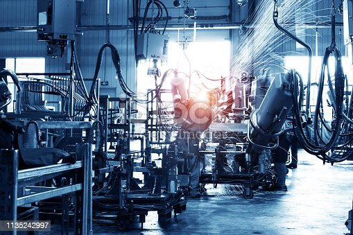 846859964 istock photo Welding robots movement in a car factory 1135242997
