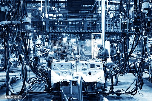 846859964 istock photo Welding robots movement in a car factory 1135243041