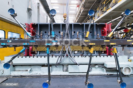846859964 istock photo Welding robots movement in a car factory 1136383461