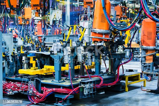 846859964 istock photo Welding robots movement in a car factory 1136383578