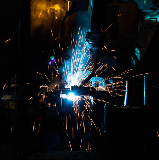 welding robots movement in a car factory - transport conductor stock photos and pictures