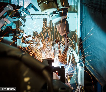 846859964 istock photo Welding robots movement in a car factory 674880302