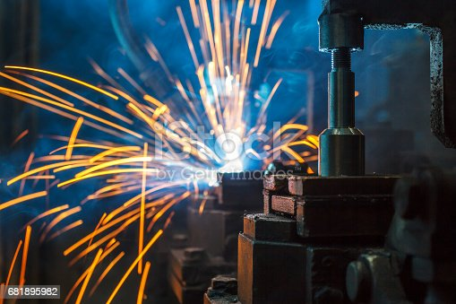 156642859 istock photo Welding robots movement in a car factory 681895982
