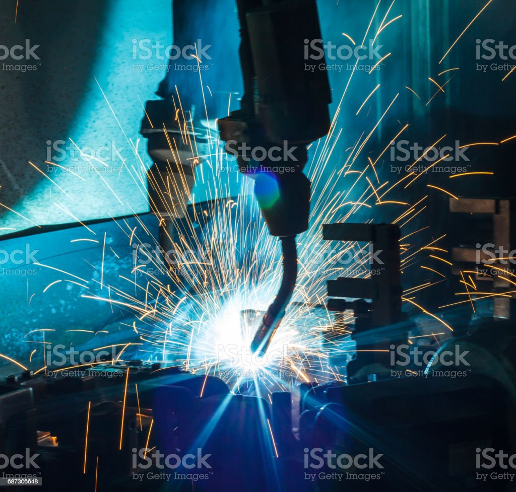 Welding robots movement in a car factory, – Foto