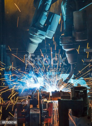 846859964 istock photo Welding robots movement in a car factory, 687309746