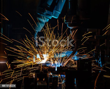 846859964 istock photo Welding robots movement in a car factory, 687313224