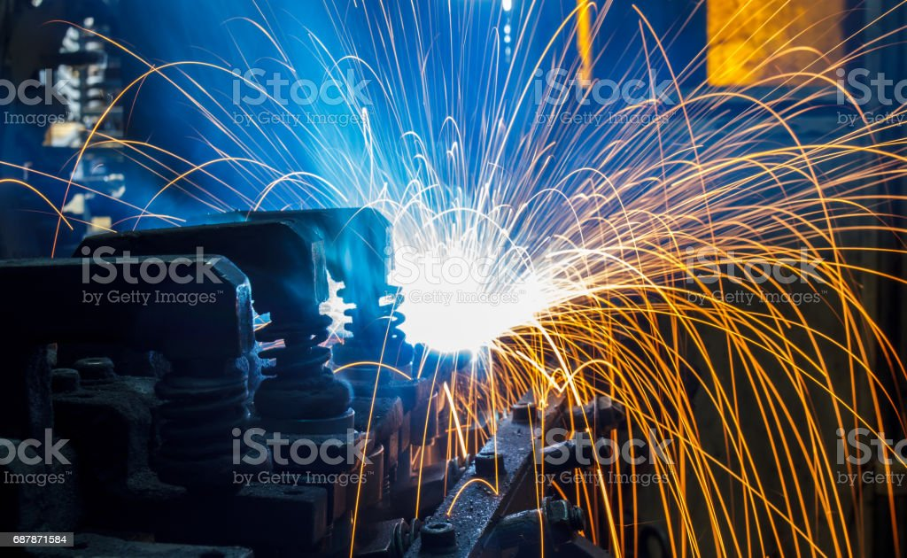 Welding robots movement in a car factory – Foto