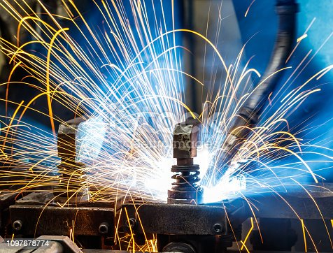 istock Welding robots on industrial factory. 1097678774