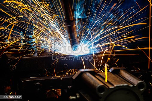 istock Welding robots on industrial factory. 1097680002