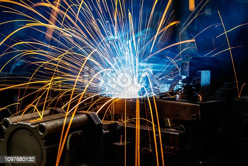istock Welding robots on industrial factory. 1097680132