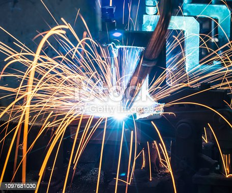 istock Welding robots on industrial factory. 1097681030