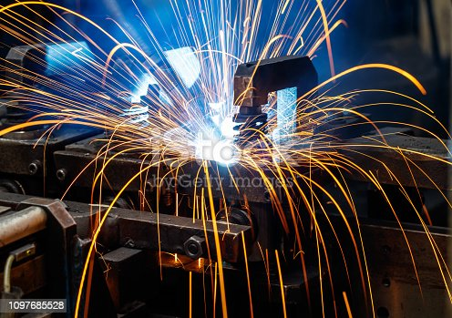 istock Welding robots on industrial factory. 1097685528