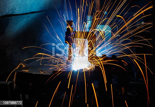 istock Welding robots on industrial factory. 1097688772