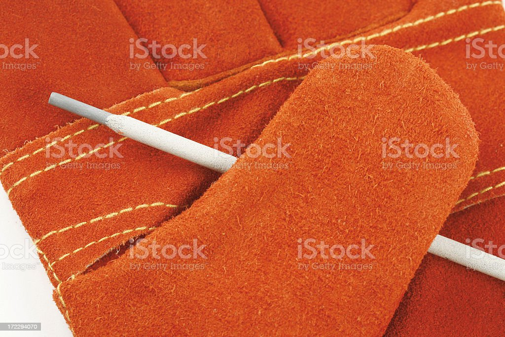 Welding Rod and Glove royalty-free stock photo