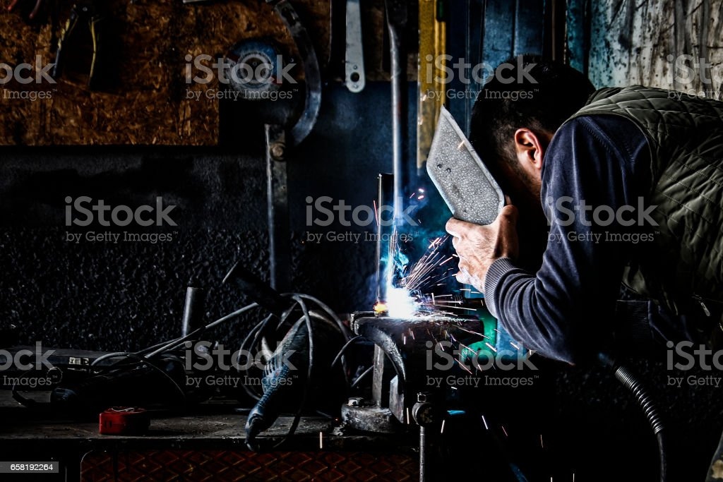 welding sparks - cutting pipes welding sparks - cutting pipes - metall pipes 2015 Stock Photo