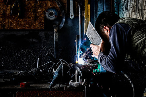 Welding Sparks Cutting Pipes Stock Photo - Download Image Now