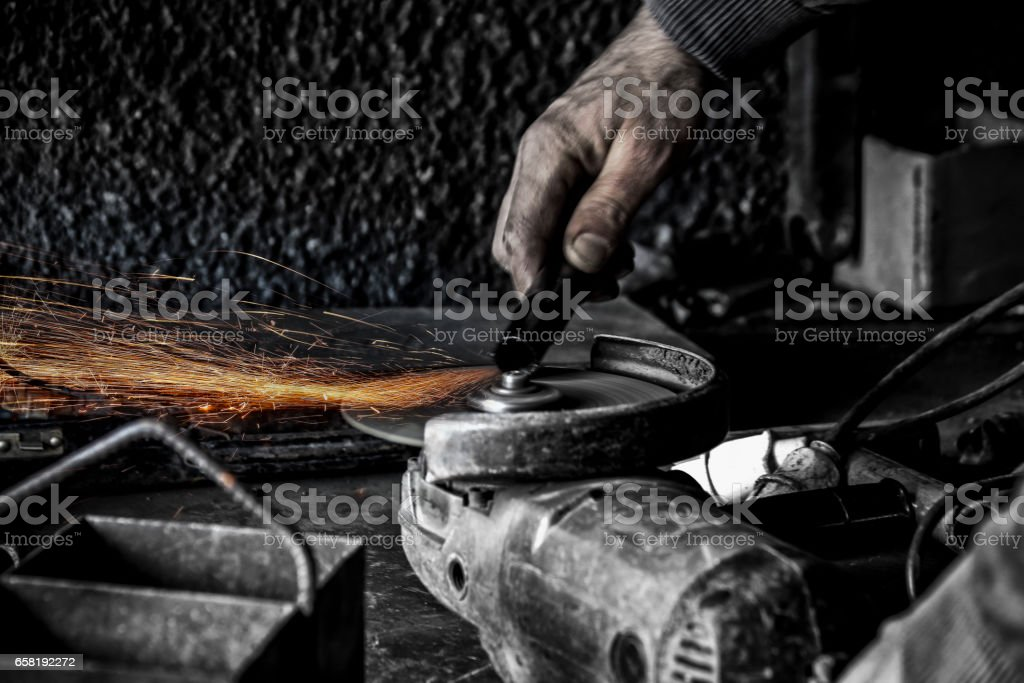 welding sparks - cutting pipes stock photo