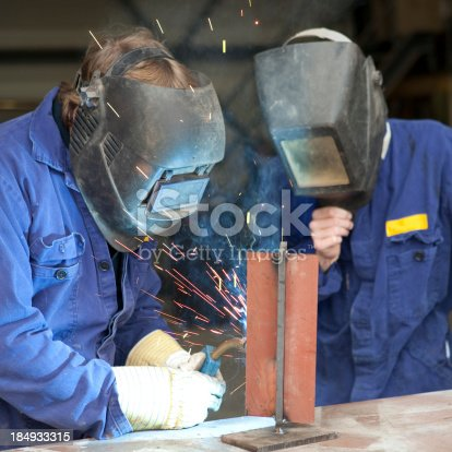 Welder with young female apprentice.If you want more images with a trainee please click here.