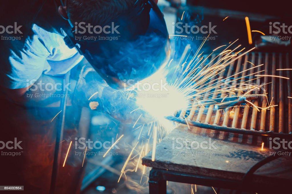 Welding Work. Erecting Technical Steel Industrial Steel Welder In Factory. Craftsman. stock photo