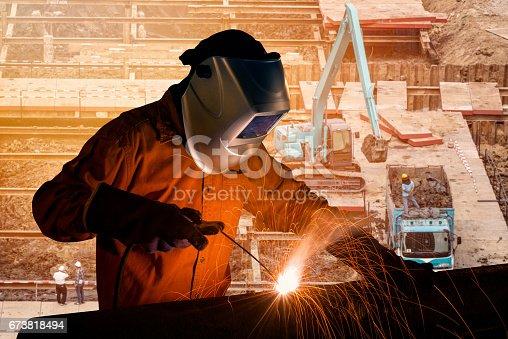 istock Welding worker welding steel structure 673818494