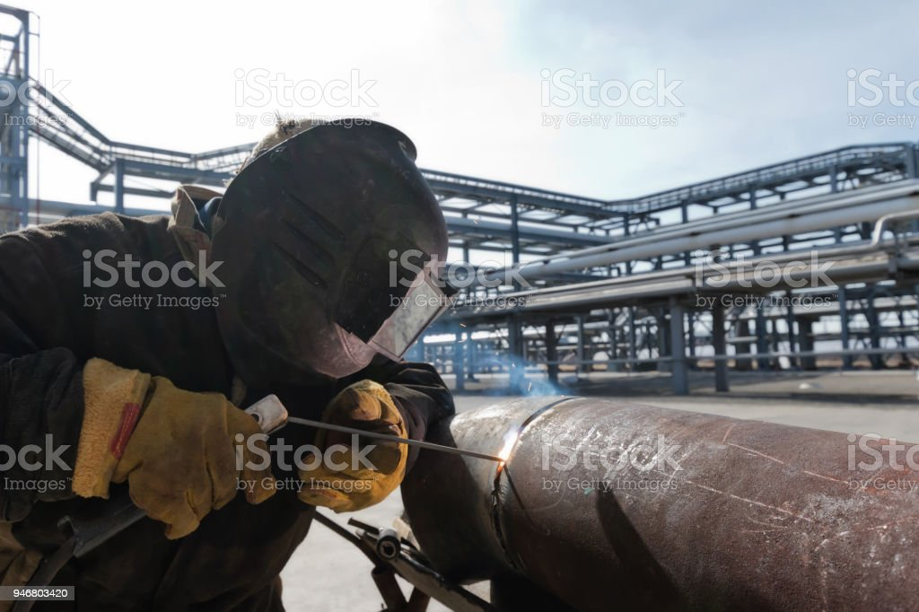 Welding works at installation of the new pipeline on oil refining...