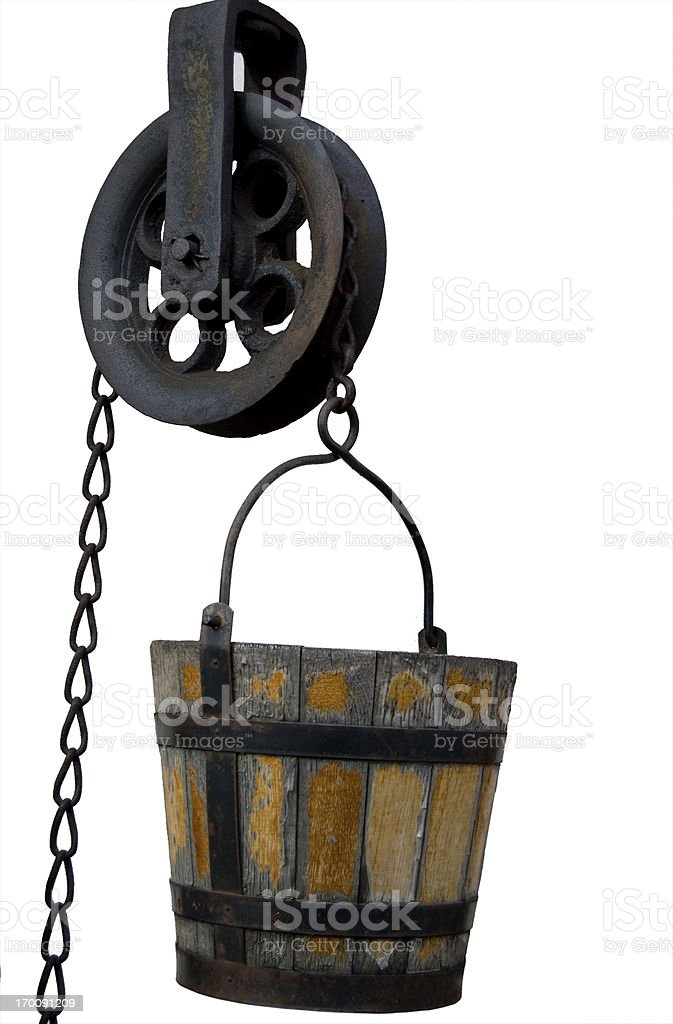 Well Bucket and Pulley A antique well bucket and pulley isolated with clipping path. Ancient Stock Photo