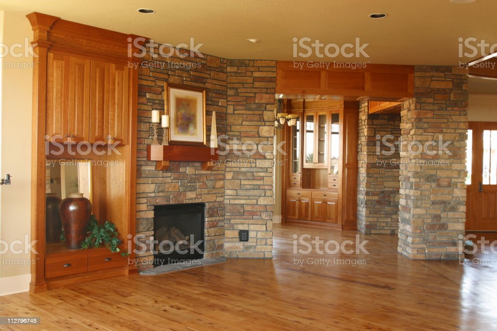 Well built home with fireplace and hardwood floor royalty-free stock photo