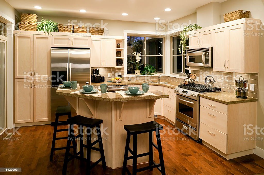 Well Designed Bright Kitchen In Modern Home Stock Photo