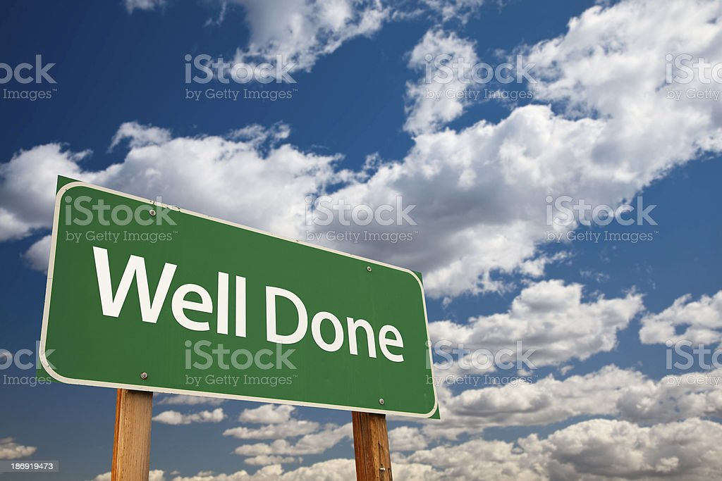 Well Done Green Road Sign with Sky stock photo