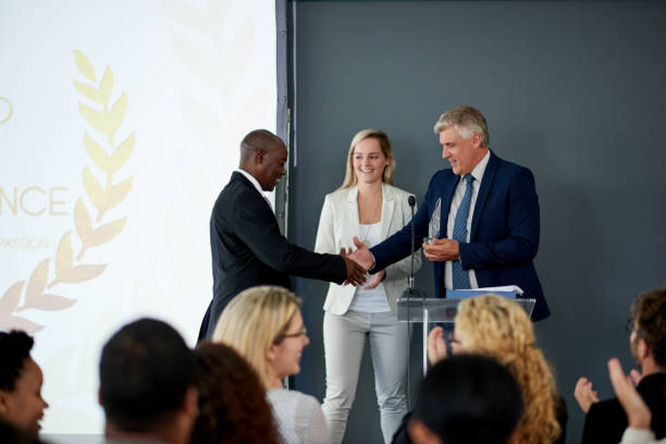 well done on this great achievement - awards ceremony stock photos and pictures