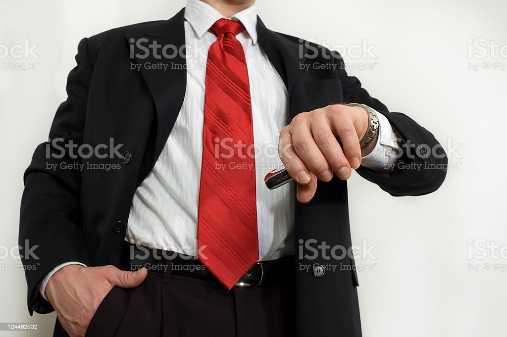 Well dressed business man checks his wristwatch royalty-free stock photo