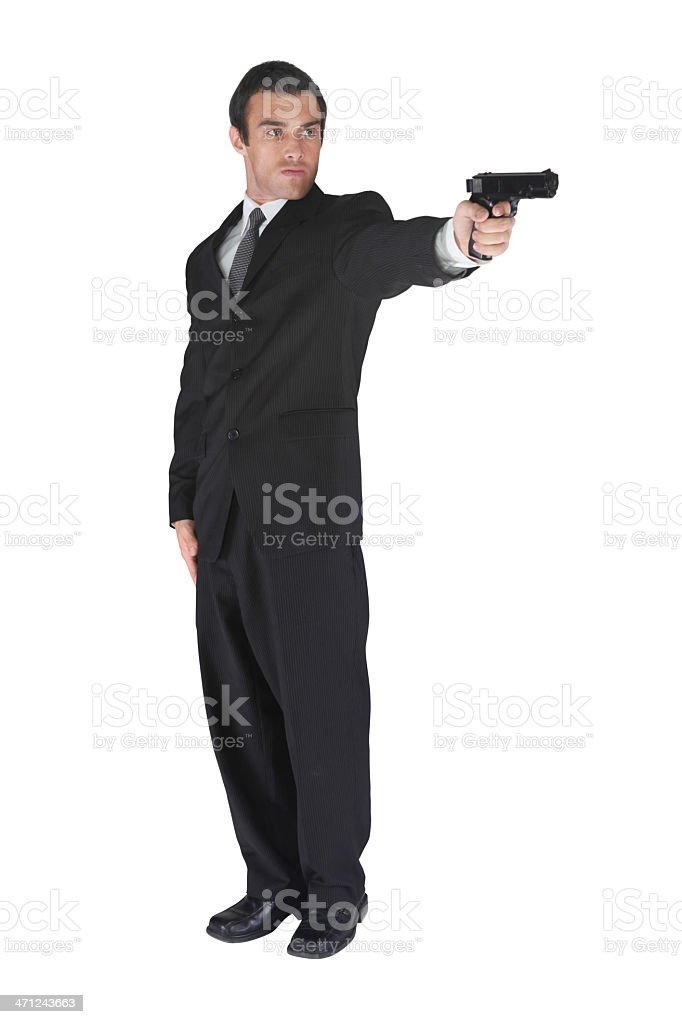 Well dressed businessman assassin with gun stock photo