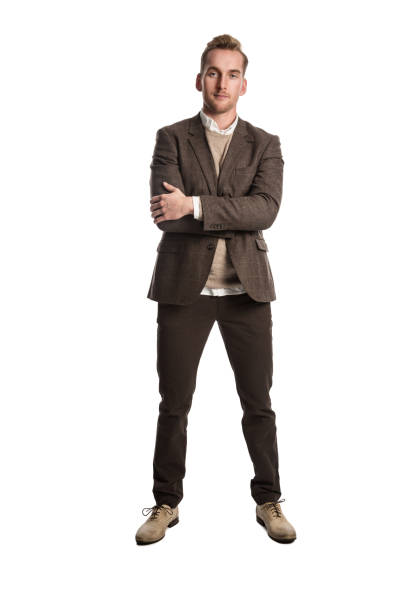 Well dressed businessman in brown Attractive businessman in a brown suit and beige pullover shirt, standing against a white background smiling. blazer jacket stock pictures, royalty-free photos & images